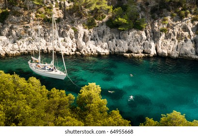 Yacht and three Swimmers in the Bay, Cassis, Southern France