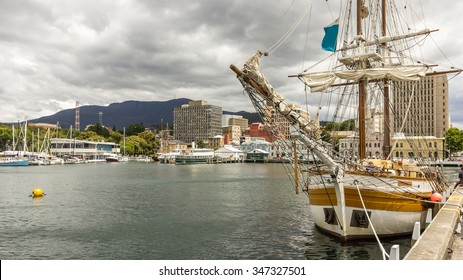 Yacht Tour Boat at Wharf in Hobart Harbour with Kunanyi Mount Wellington background under Dramatic Sky, Derwent River, Hobart, Tasmania