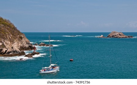 Yacht with tourists near Mexican pacific coast of Huatulco