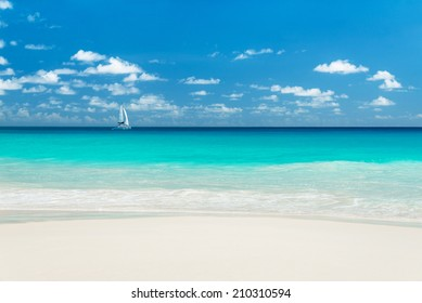 Yacht at tropical sandy beach. Anse Georgette, Praslin island, Seychelles - vacation background