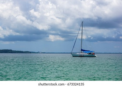 Yacht in the tropical sea at sunny day in Kuraman island of Labuan,Malaysia.Dramatic cloudscape.Photo with Copy Space.