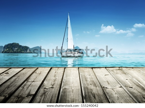 yacht and wooden platform