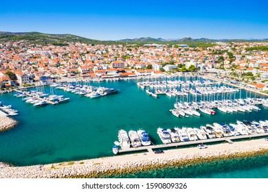 Yachting marina in town of Vodice and amazing turquoise coastline on Adriatic coast, aerial view, Croatia