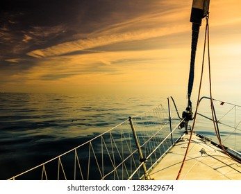 Yachting on sail boat during sunny summer weather on calm sea water. Sporty transportation concept.