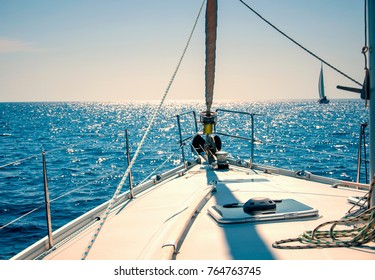Yachting on sail boat during sunny weather