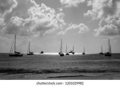 Yachts are anchored in the Carlisle bay of the Caribbean island of Barabados. Black and white photography.
