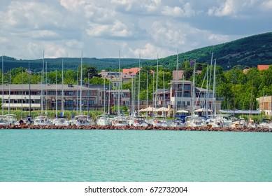 Lot of yachts anchored near the Balatonfured town at coast of Balaton lake, the famous resort area of Hungary.