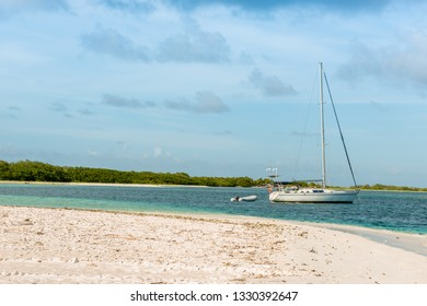 Yachts anchored in turquoise waters at Las Aves Island, Venezuela. The Aves Island is a small Venezuelan island of 4.5 hectares located in the Caribbean Sea.
