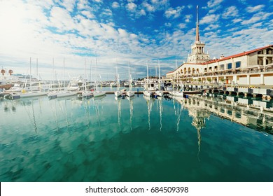 Yachts and boats anchored in the port of Sochi at sunset. Russia.