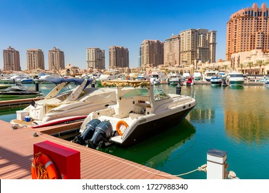 Yachts and boats in harbor marine in summer day, Doha, Qatar. All logos were removed