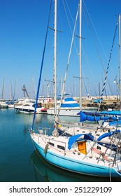 Yachts and boats in old port in Mediterranean sea