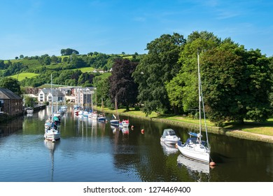 yachts and boats on the river dart in the town of totnes, devon, england, britain, uk.