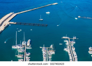 Yachts, boats and sailboats docked at the marina in summer in Castellammare del Golfo in Sicily, Italy