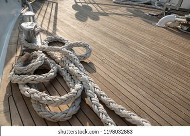 Yachts bow covered with teak wood background.