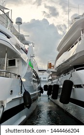 Yachts docked side by side separated by dock bumpers and boat fenders at the Fort Lauderdale International Boat Show