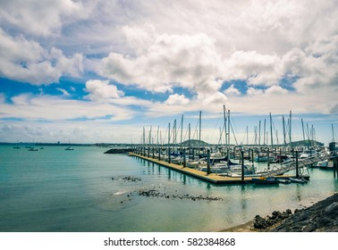 Yachts docking at the wharf in Auckland, New Zealand. Peaceful Landscape as Background.