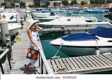yachts. girl on the pier