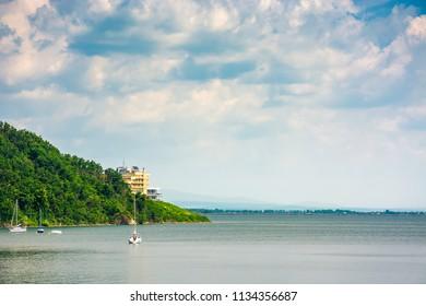Yachts in harbor of Zemplinska Sirava lake, Slovakia. two sailboats stand still, safe vacation in summer