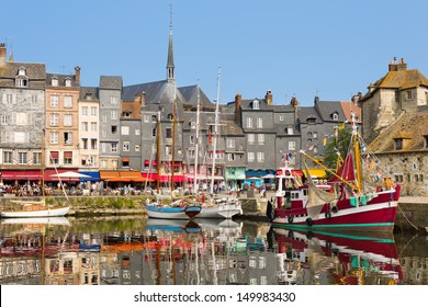 Yachts in the Honfleur harbor in a summer day