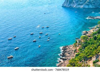 Yachts at Marina Piccola in Tyrrhenian Sea of Capri Island, Italy