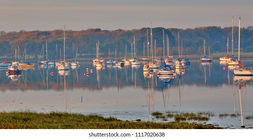 Yachts moored in Chichester Harbour at Apuldram, (Fishbourne Channel), West Sussex, England, UK.