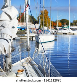 Yachts moored in a marina in Riga on a clear sunny autumn day
