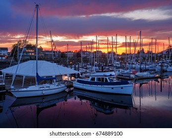Yachts moored at the marina at the sunset