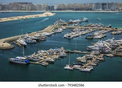 Yachts moored near Dubai Marina. View from skyscrapers in Dubai Marina. Dubai, United Arab Emirates.