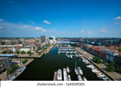 Yachts at the oldest harbor district of Antwerp city called Eilandje. Used as a yacht marina with waterfront promenade, Antwerp Province, Belgium