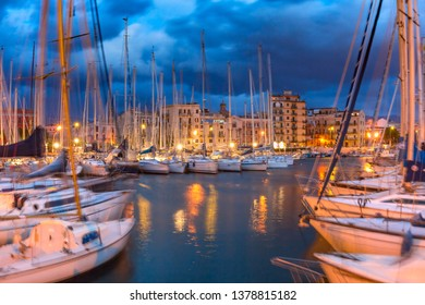 Yachts in the oldest port in the city of Palermo, La Cala, during morning blue hour, Sicily, southern Italy
