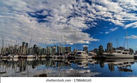 Yachts parked in the harbor in Vancouver with the city in the background