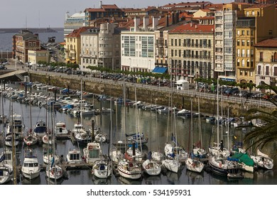 Yachts and pier in leisure port on maritime fishing district of Gijon, Spain, Europe.