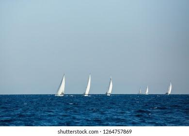 Yachts at Sailing regatta. Sailing in the wind through the waves at the Sea.
