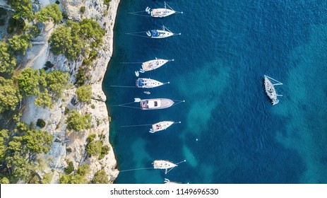 Yachts at the sea in France. Aerial view of luxury floating boat on transparent turquoise water at sunny day. Summer seascape from air. Top view from drone. Travel concept and idea