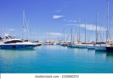 yachts and speed boats at harbor. yachts moored in the port. Ocean Coast pier. High class lifestyle. Yachting. Expensive toys. Sea transport. Journey. Yachting sport. Expensive yachts at the pier