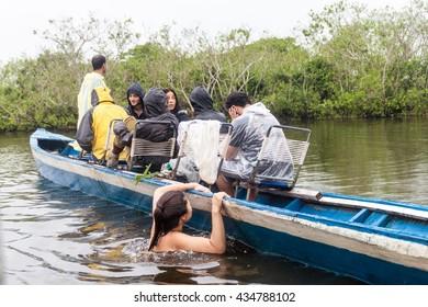 YACUMA, BOLIVIA - MAY 6, 2015: Tourists on a dolphin watching tour on Yacuma river, Bolivia