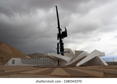 Yafit, Israel - March 25, 2019: Jordan Valley Monument for fallen soldiers of the IDF with dark clouds in west bank. The monument was created in 1972 by the Israeli sculptor Yigal Tumarkin.