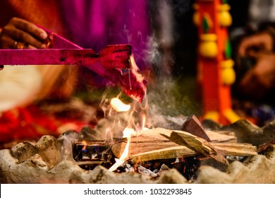 Yagya a fire flame ritual of hindu pooja performating during wedding ceremony - Shutterstock ID 1032293845