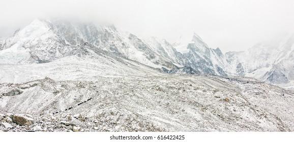 The yak caravan on the trek to Mount Everest near Gorak Shep after snowfalls. Nepal, Himalayas