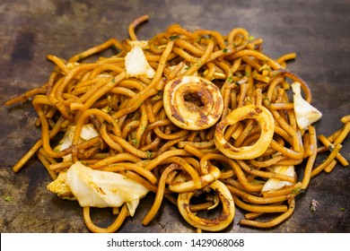 Yakisoba, fried buckwheat, stir-fried noodles with with vegetables and squid on large pan