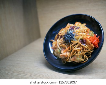 Yakisoba mock up on wood background,yakisoba in flat lay composition with copy space