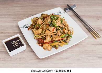 Yakisoba with soy sauce on a wooden table
