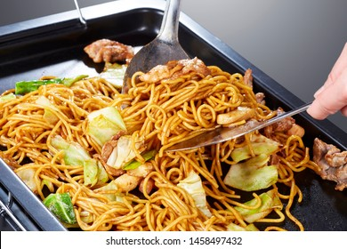 Yakisoba (stir fried noodles with pork or seafood, vegetables, and a sweet and salty sauce)