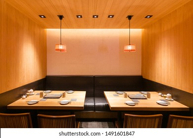 Yakitori Japanese Grilled Skewer Restaurant private seating area. Mostly decorated with oak wood texture. Minimalist interior design.