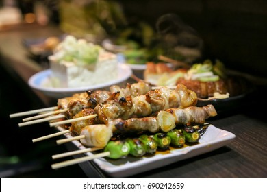 Yakitori is a Japanese type of bamboo skewered chicken. During or after cooking, the meat is typically seasoned with tare sauce or salt. Sometime people eat vegetables with grilled skewers together.