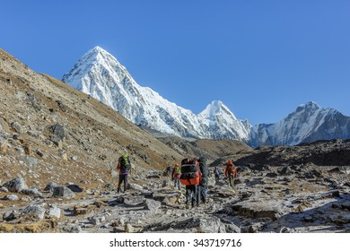 Yaks caravan on the trek at the foot of Mount Everest (8848 m) near Gorak Shep village - Nepal, Himalayas