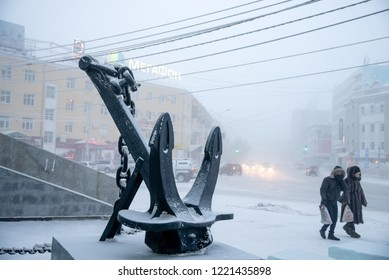 Yakutsk, Republic of Sakha (Yakutia)/Russia - December 14 2014: Anchor sculpture. Lifestyle in fog city at winter