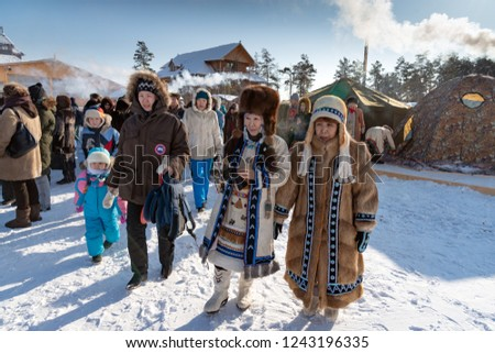 da57125546825 Yakutsk, Republic of Sakha (Yakutia)/Russia-March 01 2015: women in traditional  clothes and fur hats at the festival of the Meeting of the Sun - Image