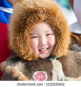 Yakutsk, Republic of Sakha (Yakutia)/Russia-March 18 2017: Yakut child in a red fur hat and national clothes at the festival of reindeer herders