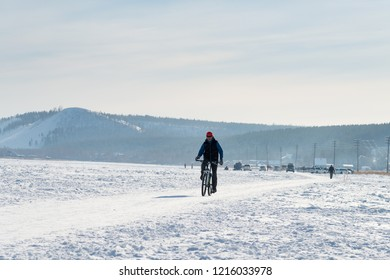 Yakutsk, Republic of Sakha (Yakutia)/Russia-March 20 2016: cyclist on snow track in winter